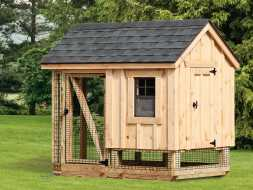 This chicken coop is smaller but still offers enough room with its run area, built with wood siding and a shingled roof.