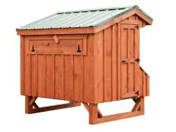 Chicken Coop featuring metal roof and board and batten siding along with nesting boxes and ventilation window.