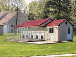 This custom dog kennel features, 5 runs plus a room for storage.