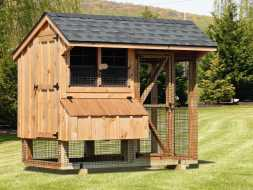 This chicken coop features nesting boxes, a screened in run area and ventilation windows.