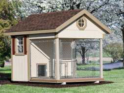 This small dog kennel has windows, chainlink run area, and durable wood construction.