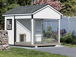 Dog Kennel with painted wood exterior, and shingle roof, and sits on crushed stone base.