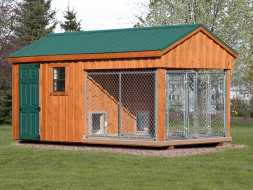 Dog Kennel with 2 runs for larger dogs, features cedar siding and metal roof.
