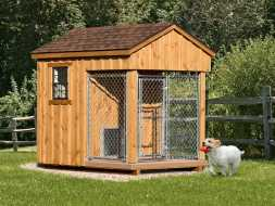 Small dog kennel cedar board batten exterior, with shingle roof, and chainlink open run area.