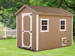 Chicken Coop with vertical painted siding, and white trim, with a shingled roof plus a full sized walk door.
