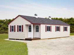 Large dog kennel, able to be climate controlled, vinyl siding exterior, lots of windows, lots of room.