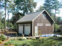 This personalized 24x24 two car garage features painted siding, metal roofing, and upstairs loft area for storage.