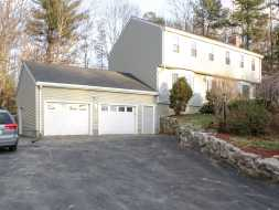 This big 2 car garage features vinyl siding, shingled roof & matches the house.