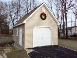 Custom 16 x 24 detached garage with vinyl siding walls & shingled roof.