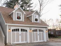 This personalized garage features 2 story, exterior full size stairs, dormers, carriage house garage doors, & electrical.