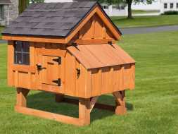 Chicken Coop is small with nesting boxes, and is built with cedar construction and a shingled roof.