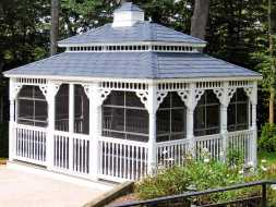 This screened gazebo is large, has beautiful looks, and a cupola.