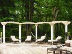 This pergola is personalized featuring arched tops and a unique design.