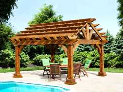 This Stained cedar pergola is unique with its gable design and looks good beside the pool offering place to relax.