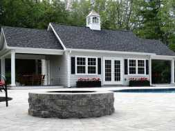 This large poolhouse features double porch areas, and is finished out inside with T & G board, and has electrical.