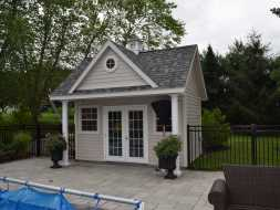 Poolhouse with A-frame dormer, changing room and small porch area, great compliment to the pool area