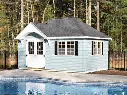 This pool house with a dormer over door and hip roof design, featuring plenty of room for storage and pool equipment.
