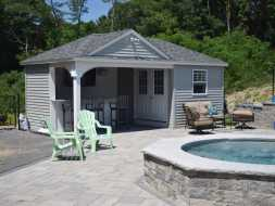 This pool house has storage area plus changing room and full bar sitting area.