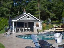 This beautiful poolhouse includes a bathroom changing area, plus a storage room, and also there is full bar.