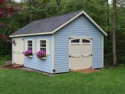This backyard storage shed looks good and is durable with vinyl siding and shingle roof, plus has 2 double doors for easy access