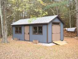 This garden storage shed is custom built with added windows and personalized color options.