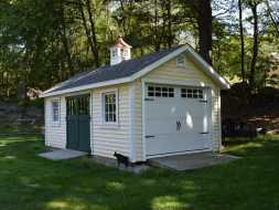 This outdoor storage shed has a roll up garage door plus ramp and is made with the most durable materials and with cupola accent.