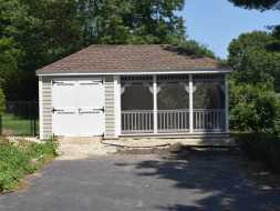 Shed has it all with storage area and also a full screened in sitting area for outdoor relaxing.
