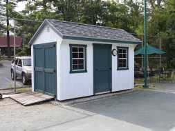 Commercial shed featuring T1-11 siding  saltbox style roof.