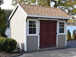 This small storage shed is built to last and look good with durable painted siding and shingled roof.
