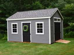 This storage shed is good looking with its vinyl siding exterior and shingle roof and is very practical with double doors and equipment ramp
