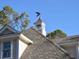 Custom cupola with polished copper roof and a eagle weathervane.
