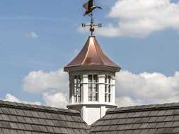 Weathervane and cupola octagon design with polished copper roof and windows.