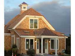 Custom cupola with unique base and personalized window choice with copper roof.