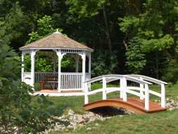 Octagon gazebo with composite deck and vinyl construction with shingled hip roof.