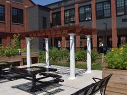 Commercially located wood/vinyl pergola, add quality and value to the outdoor sitting area.