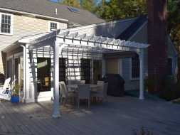 Custom attached to house pergola, made with all vinyl materials to last a lifetime.