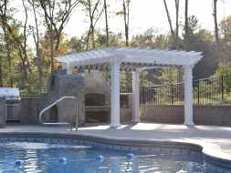 This vinyl pergola is perfect addition to this outdoor kitchen area.