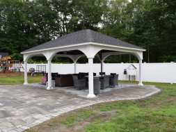 Vinyl backyard pavilion with stained wood ceiling and electric package.
