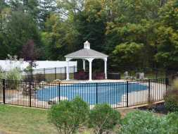 Small poolside pavilion with cupola accent, durable vinyl construction, and shingle roof