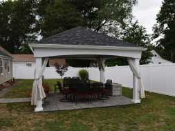 Hip roof pavilion featuring curtains and guttering also includes electrical package.