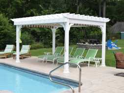 White vinyl pergola next to pool featuring a EZ shade and with the all vinyl construction it will last forever.