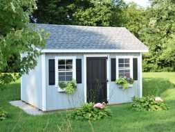 Beautiful custom storage shed with duratemp siding and flower boxes.