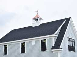 "48"" Custom cupola on a newly built home featuring windows, copper roof, and a copper eagle weathervane!"