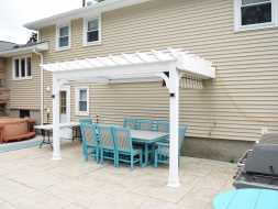 Attached to house vinyl pergola featuring square posts, electrical, and a shade canopy!