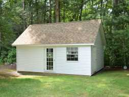Custom outdoor storage shed with vinyl exterior siding, a french door, vinyl door, and a window!