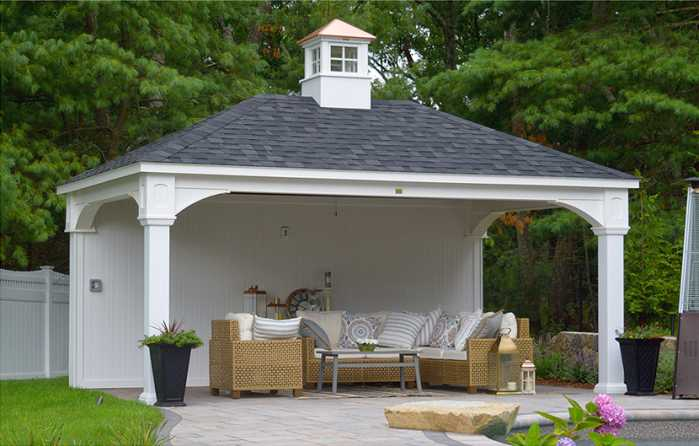 12x18 poolside pavilion surrounded by impressive hardscaping