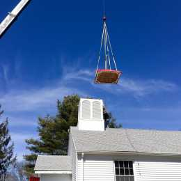 lifting the steeple's roof