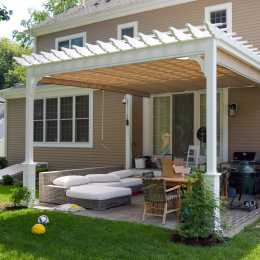 Pergola with closed shade cover