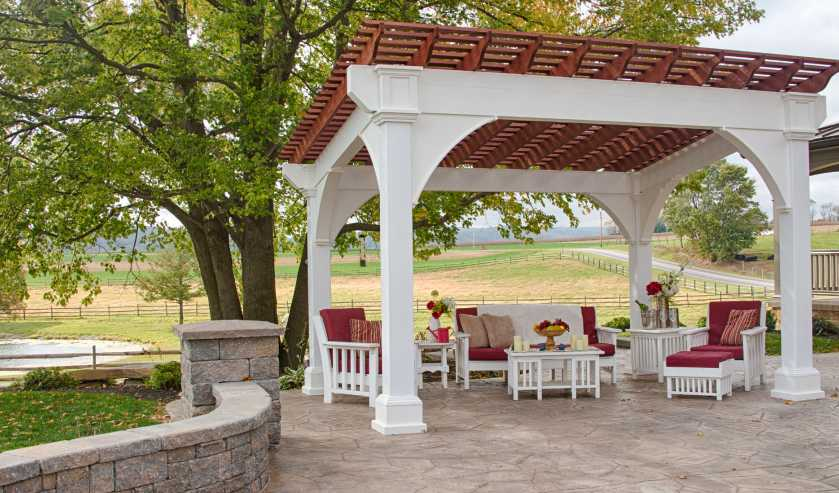 A Patio With A Pergola Over It.